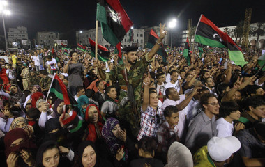 An anti-Gaddafi fighter attends a celebration rally in Tripoli