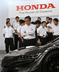 Honda Motor Co's President and CEO Ito looks at the company's racing car NSX CONCEPT GT before a photo session after a news conference on their motorsports activities, in Tokyo
