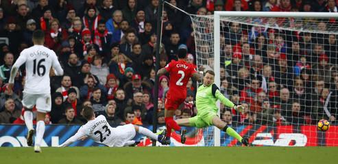 Swansea City's Gylfi Sigurdsson scores their third goal