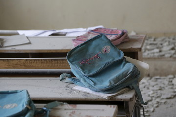 A schoolbag with the UNIFEF logo rests on a desk inside a school damaged due to what activists said was an air strike carried out yesterday by the Russian air force in Injara town, Aleppo countryside, Syria