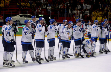 Finland's players react after losing to Sweden their 2013 IIHF Ice Hockey World Championship semi-final match at the Globe Arena in Stockholm