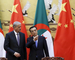 Algeria's Prime Minister Abdelmalek Sellal talks with Chinese Premier Li Keqiang during a signing ceremony at the Great Hall of the People in Beijing