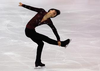 Jin Boyang of China performs during the men's singles short program at the ISU Grand Prix of Figure Skating final in Barcelona