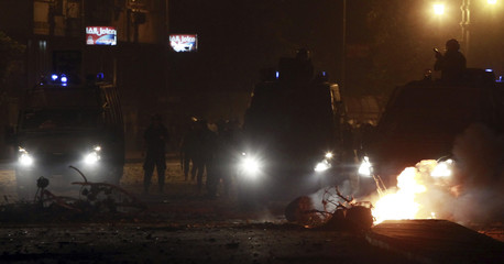 Riot police clash with protesters along a road at Kornish El Nile which leads to the U.S. embassy, near Tahrir Square in Cairo