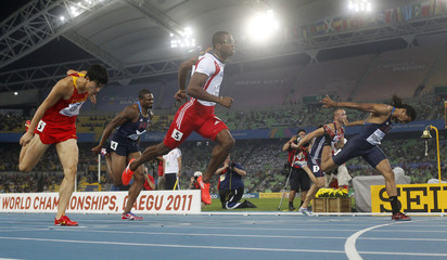 Richardson lunges at the finish line during the men's 110 metres hurdles race at the IAAF World Championships in Daegu