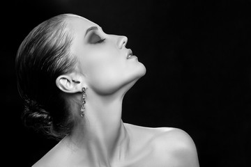 sensual aroused woman profile on black background with copy space monochrome