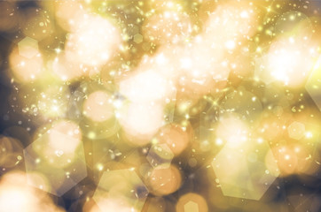 Gold glitter sparkles rays lights bokeh Festive Elegant abstract background. Vintage or retro tone.