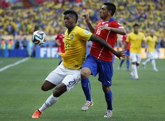 Brazil's Jo  fights for the ball with Chile's Jara during their 2014 World Cup round of 16 game at the Mineirao stadium in Belo Horizonte