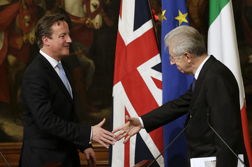 Italian PM Monti and British PM Cameron shake hands during their joint news conference in Rome