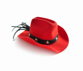Funny cute dog costume red cowboy hat with stars. Countryside clothes fashion concept. Isolated on a white background. Close up, top view.