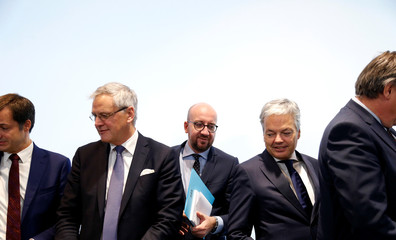 Belgian PM Michel arrives at a joint news conference with members of the federal government in Brussels