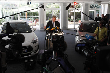 Philippe Varin, Chief Executive of French carmaker PSA Peugeot Citroen, speaksto journalists in Paris