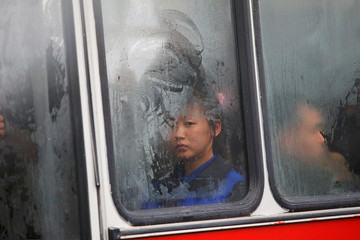 People commute on the bus near April 25 House of Culture, the venue of the Workers' Party of Korea (WPK) congress in Pyongyang