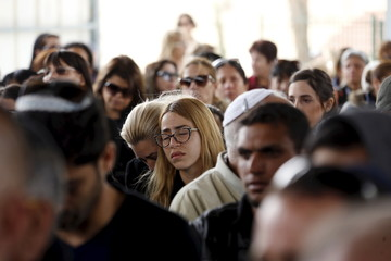 Relatives and friends mourn during the funeral of Simcha Damari, one of three Israelis killed in a suicide bombing attack in Istanbul on Saturday, in Dimona, southern Israel