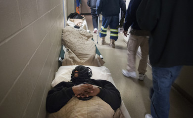 Myron Jackson sleeps on a cot in the hallway at the Atlanta Mission homeless shelter, after their rooms reached their capacity, in downtown Atlanta, Georgia