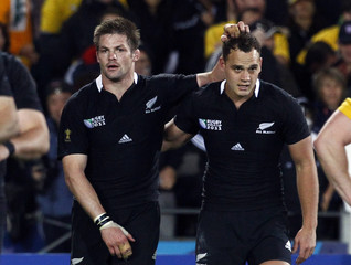 New Zealand All Blacks captain Richie McCaw hugs Israel Dagg after their Rugby World Cup semi-final match victory against Australia Wallabies at Eden Park in Auckland