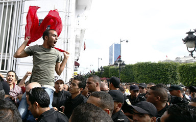 A protester shouts slogans during a protest against the government on the first anniversary of the first free Tunisian election, in Tunis