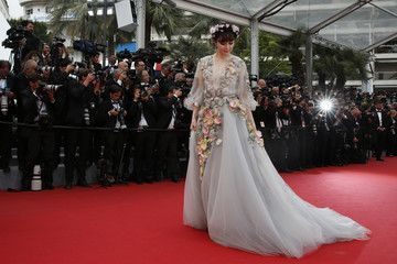 """Actress Fan Bingbing poses on the red carpet as she arrives for the screening of the film """"Mad Max: Fury Road"""" out of competition at the 68th Cannes Film Festival in Cannes"""