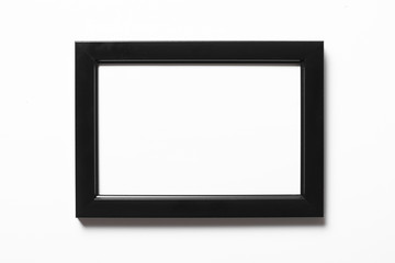 Empty copy space black photo frame isolated on white.