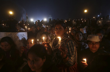 Women participate in a candlelight vigil to show solidarity with a rape victim at India Gate in New Delhi