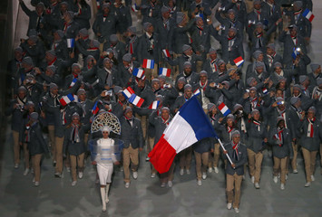 France's flag-bearer Lamy Chappuis leads contingent in athletes parade during opening ceremony for 2014 Sochi Winter Olympics