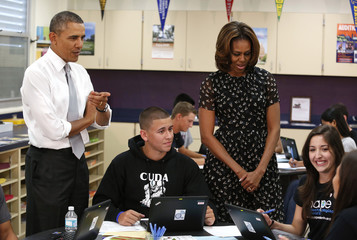U.S. President Barack Obama and first lady Michelle Obama meet with students at the Coral Reef High School in Miami