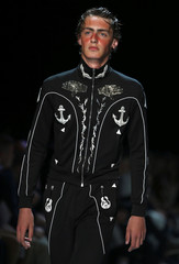 A model presents a creation at the Topman Design catwalk show at London Collections Men in London