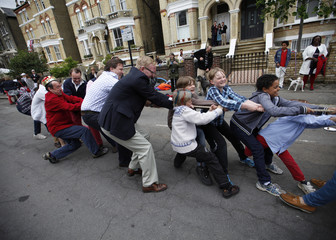 Neighbours play tug-of-war during a street party to mark Britain's Queen Elizabeth's Diamond Jubilee in Clapham, south London