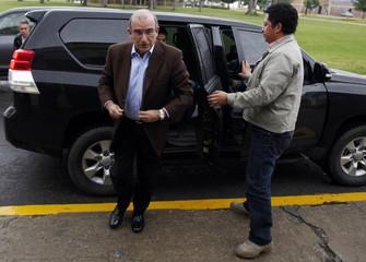 "Colombia's government head of negotiators Humberto de la Calle arrives to board a plane to ""La Havana"" at a military airport in Bogota"