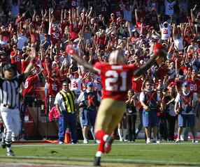San Francisco 49ers fans cheers as Frank Gore celebrates his touchdown during the second quarter of his NFL football game against the Cleveland Browns in San Francisco