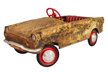 Rusted and weathered vintage toy car isolated on white