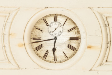Old clock enclosed in wooden panel