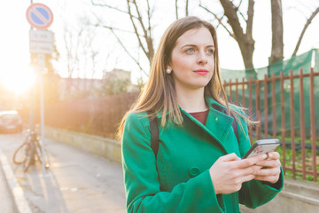 young woman outdoor using smart phone
