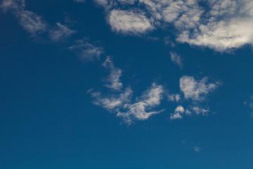 Blue sky with white cumulus clouds