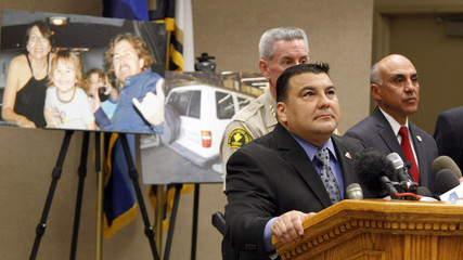 San Bernardino Sheriff Sergeant Fisher answers questions with District Attorney Ramos during a news conference about the McStay murder case in San Bernardino, California