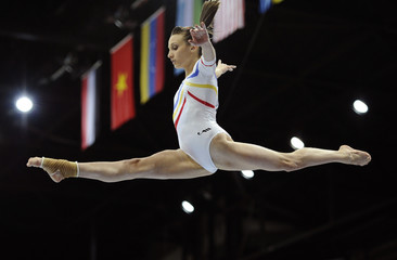 Porgras of Romania performs during the women's beam finals at the Artistic Gymnastics World Championships in Rotterdam