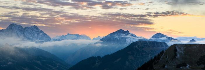 Burning sunset over mountains panorama