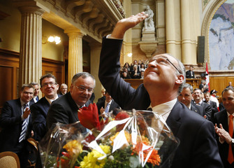 Newly elected Federal Councillor Parmelin waves after the results during the ministerial elections in the Swiss Parliament in Bern