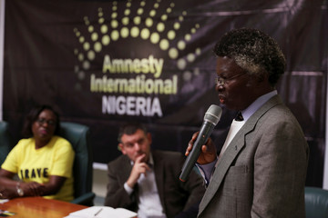 Prof. Maurice Fangnon, human rights defender, talks during the release of an Amnesty International report in Abuja
