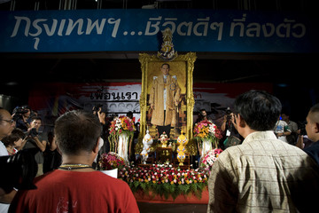 Core leaders of the anti-government red shirt movement pay their respects to the king at the anti-government protesters' encampment at the main shopping district in Bangkok