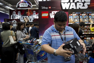 """Customers pick new toys from the upcoming film """"Star Wars: The Force Awakens"""" on """"Force Friday"""" in Hong Kong"""
