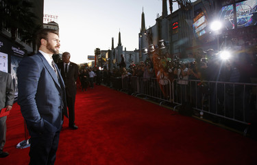 """Cast member Evans poses at the premiere of """"Captain America: The Winter Soldier"""" at El Capitan theatre in Hollywood"""