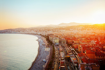 Foto op Plexiglas Nice cityscape of Nice with beach and sea at sunset, French Riviera, France, retro toned
