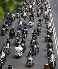 Motorcyclists ride down a central avenue during the 9th annual Harley Davidson owners get-together in Madrid