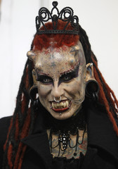 "Mexican tattoo and body modification artist  Maria Jose Cristerna, also known as ""Mujer Vampiro""  (Vampire Woman), poses for pictures during the International Tattoo Convention in Bogota"