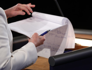 Clinton flips a page on her notepad during the third and final 2016 presidential campaign debate at UNLV in Las Vegas