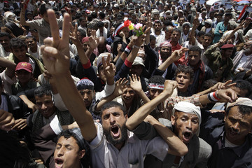 Anti-government protesters shout slogans during a rally in Sanaa
