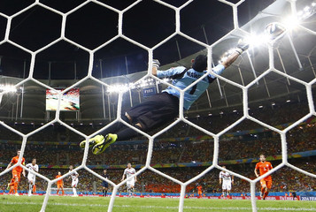 Costa Rica's goalkeeper Navas jumps to deflect the ball during their 2014 World Cup quarter-finals against the Netherlands at the Fonte Nova arena in Salvador