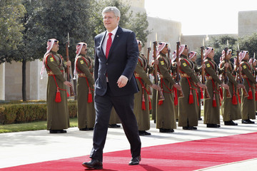 Canada's Prime Minister Stephen Harper walks after reviewing Bedouin honour guards during his visit to Jordan at the Royal Palace in Amman