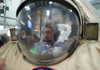 Russian cosmonaut Misurkin, seen through the helmet of his spacesuit, takes part in a spacewalk training exercise at the cosmonaut training centre in Star City outside Moscow
